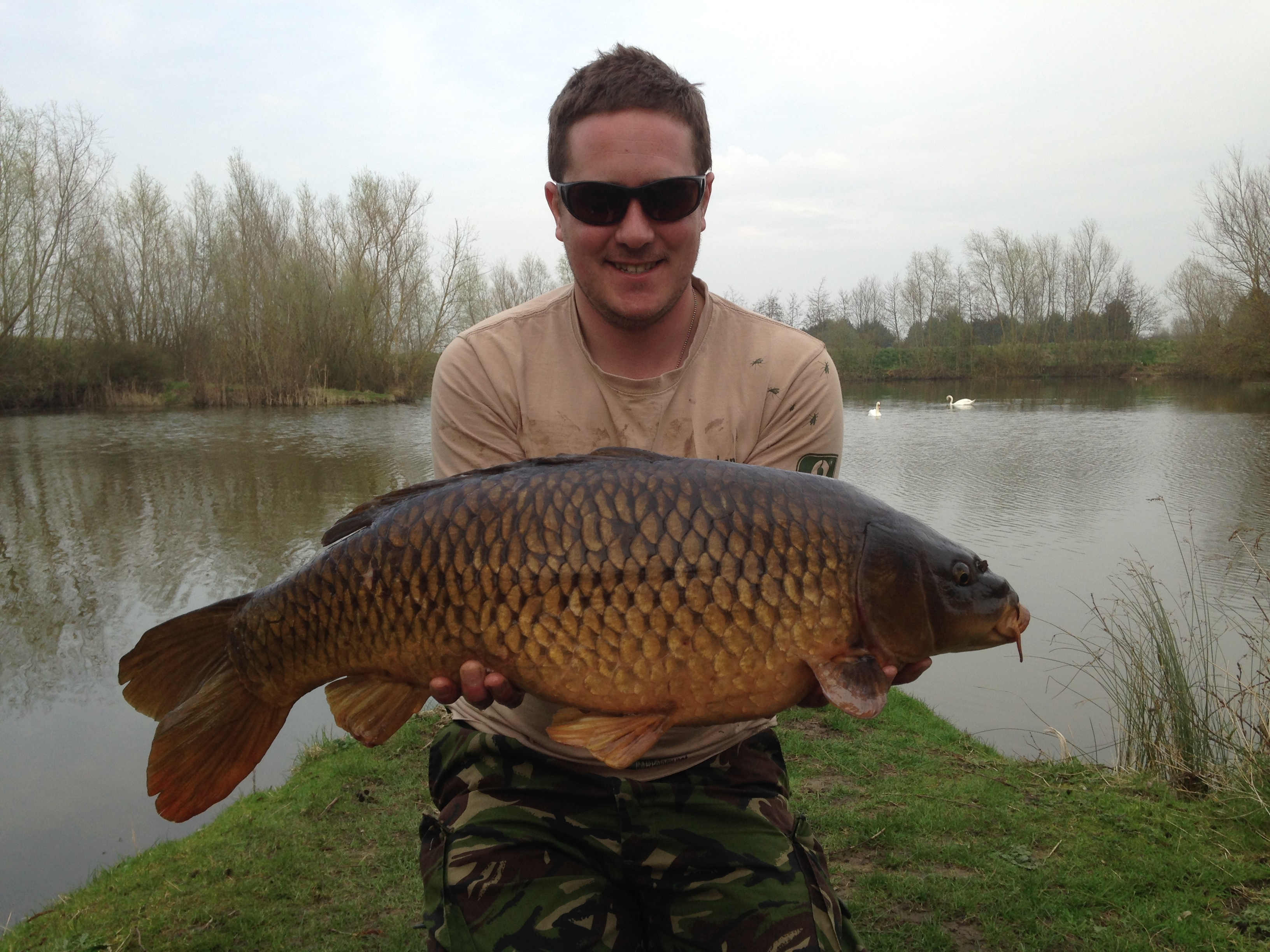 Liam Slee with a 16lb Carp caught from Heritage Lake.